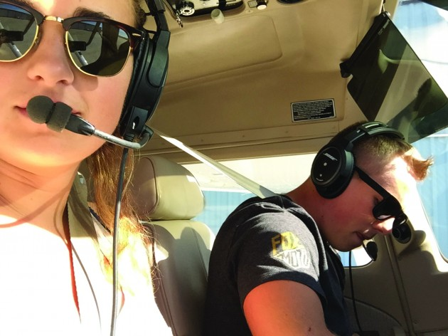 Owls Take to the Sky:  Two Students Earn Their Pilot's License