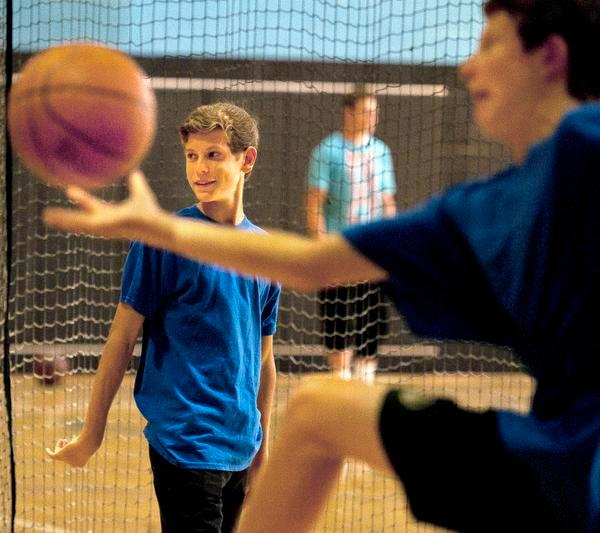 Ryan McCormick, 15, of Laguna Niguel, on the court at the YMCA on Sunday morning.  ///ADDITIONAL INFO: 13.ocr.family_cover.0923.db.jpg -- 9/14/14 -- PHOTO BY DAVID BRO, CONTRIBUTING PHOTOGRAPHER----The Basketball Buddies --- OC Family Cover ---