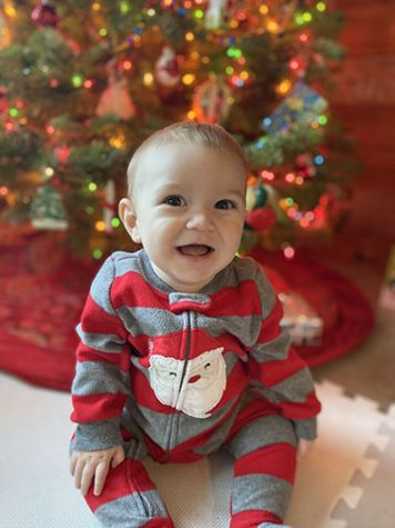Patrick, Roarty's son, smiles by the Christmas tree.
