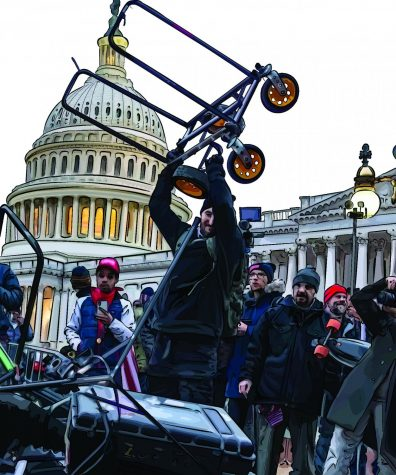 A rioter prepares to smash a news-crews video equipment on the ground at the Capitol Riot, January 6th, 2021.