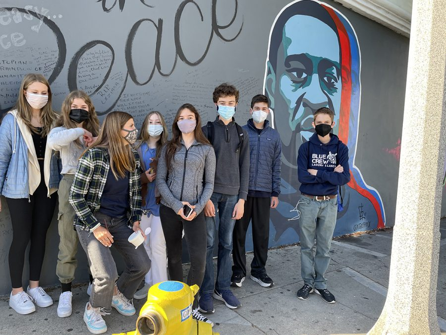 Mask-wearing freshmen gather in front of the George Floyd mural in downtown Santa Barbara.