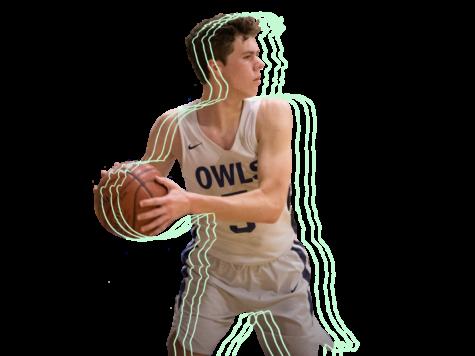 Senior Finn Walker passes the ball during a league basketball game.